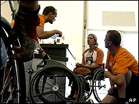 Athletes at a wheelchair repair shop in Athens