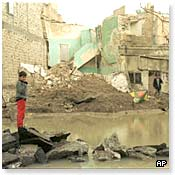 An Iraqi child amid bomb damage at a residential site in southern Baghdad 17 December 1998