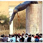 Statue of Saddam Hussein toppled in Baghdad, April 2003