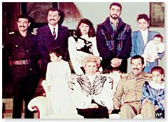 Saddam Hussein with his family