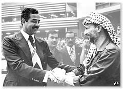 Iraqi President Saddam Hussein meets Yasser Arafat, then leader of the Palestinian