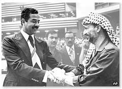 Iraqi President Saddam Hussein meets Yasser Arafat, then leader of the Palestinian