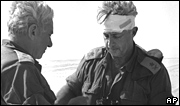 Maj Gen Ariel Sharon, right, views a map with Maj Gen Haim Bar-Lev in the Sinai desert, in October 1973