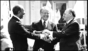 Egyptian President Anwar Sadat, US President Jimmy Carter and Israeli Prime Minister Menachem Begin on the lawn of the White House after signing the peace treaty between Egypt and Israel on March 26, 1979