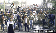 Thousands of Arabs emerge from the Nusseirat refugee camp during the Palestinian uprising in 1987