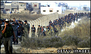 Israeli security forces head for Kfar Darom during the forced evacuation of settlements in the Gaza Strip in 2005