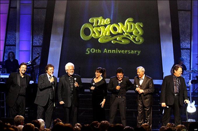 Jay, Jimmy, Wayne, Marie, Donny, Merrill, & Alan Osmond