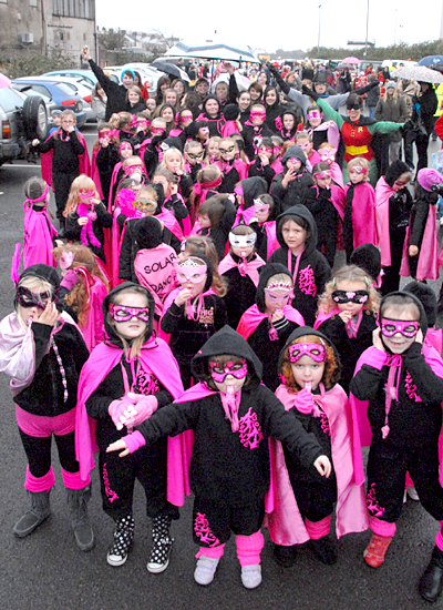 the super heroes from solar dance school in port talbot took part in the towns father christmas parade sponsored by steel maker corus which ended with