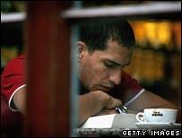 Man contemplates a coffee