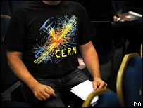 Science fan wearing a particle physics T-shirt