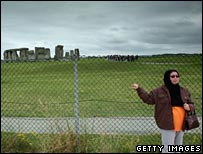 Stonehenge visitor poses for a photo
