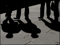 Shadows of commuters crossing London Bridge