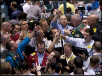 Traders deal in the crude oil futures pit of the New York Mercantile Exchange