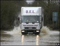 Lorry on flooded road