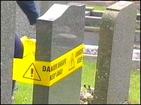 Gravestone with safety tape