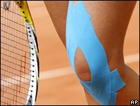 Strapped knee of tennis player