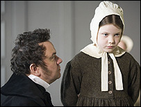 Mr Brocklehurst conronts a young jane in a BBc adaptation of Jane Eyre