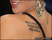 Danielle Lloyd's latin tattoo