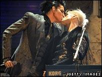 Adam kissing musician