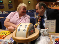 Scotland's First Minister Alex Salmond talks to bingo player Betty Fraser during the Glasgow North East by-election campaign