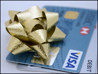 A gold bow on top of two credit cards