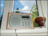 A digital radio on a windowsill