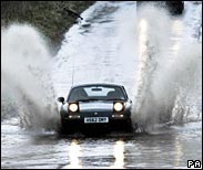 Car driving through a puddle
