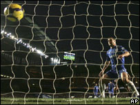 Chelsea's Ivanovic looks on as the ball goes into the net and Everton score