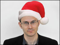 Tim in a Santa hat