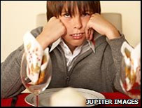 Boy at dinner table