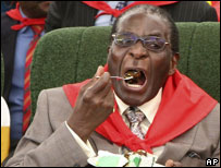 Mugabe eats cake on his birthday