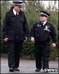 Smallest police officer, with a 6ft cop