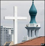 Cross and minaret on roofline