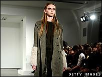 Model with sheepskin armlets