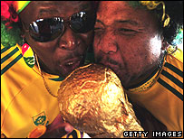 South African fans kissing a copy of the World Cup