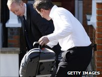 David Cameron with a booster seat