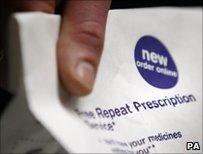 Man holding prescription in pharmacy bag