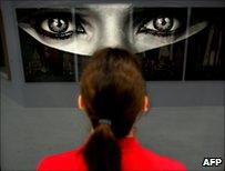 Woman looking at the work Burka by US artist Robert Longo