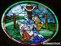 Jesus on cross stained glass window