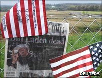 US flags and newspaper clippings with headline: Bin Laden dead