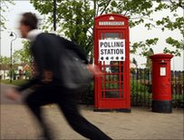 Schoolboy runs past polling station sign