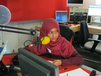 School Reporter sitting in radio studio