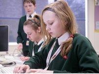 School Reporter using computer