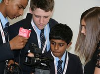 School Reporters using a camera