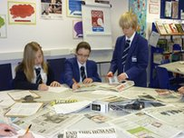 School Reporters look at a pile of papers