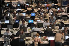 Journalists working in a newsroom
