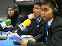 School Reporters sit in a studio