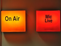 On Air and Mic Live signs in a radio studio