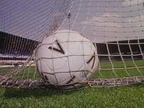 A football in the back of the net