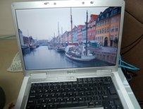 A laptop showing an image of a boat on a river